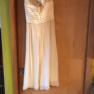 BCBG Paris Dresses - BCBG tea length cream colored halter dress